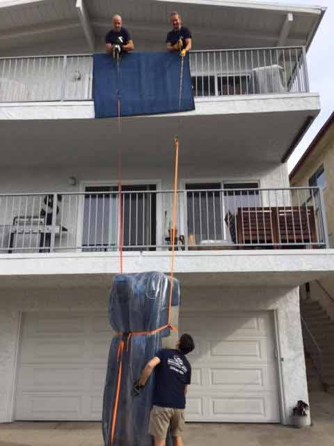 Moving couch through a second story balcony
